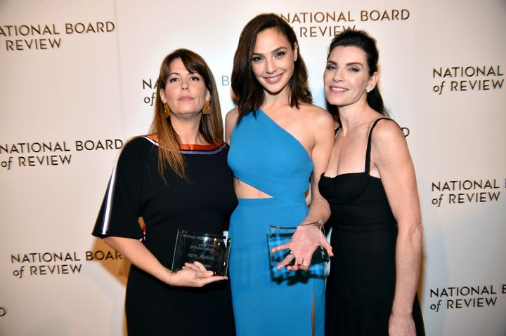 "Patty Jenkins, left, who won a Spotlight Award, poses along with her ""Wonder Woman"" actress Gal Gadot and Julianna Margulies."