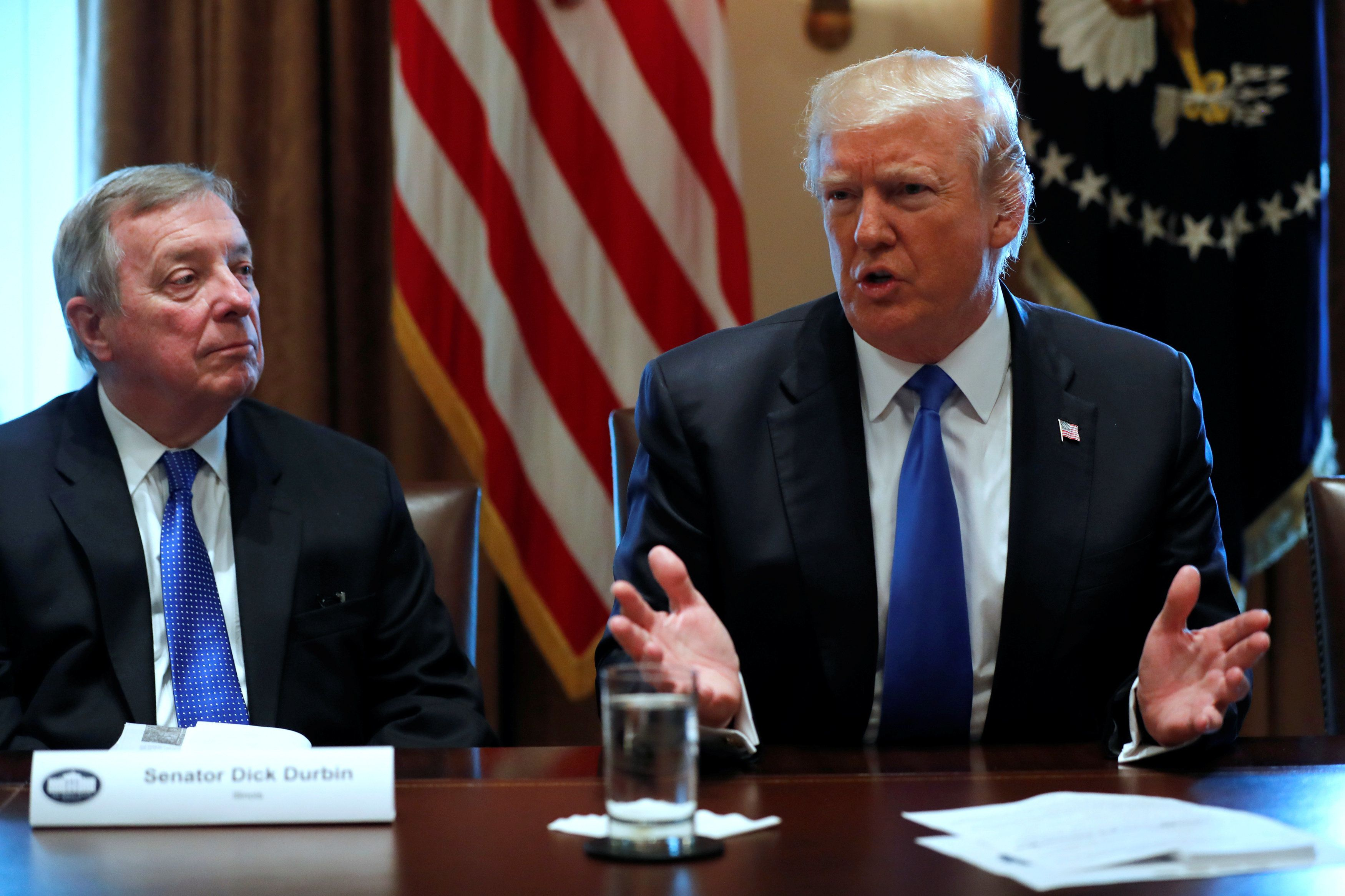 U.S. President Donald Trump, flanked by U.S. Senator Dick Durbin (D-IL), holds a bipartisan meeting with legislators on immigration reform at the White House in Washington, U.S. January 9, 2018.  REUTERS/Jonathan Ernst