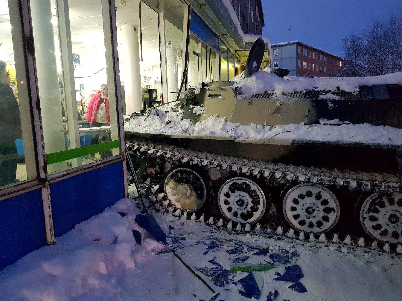 A view shows the scene of an incident involving an armoured personnel carrier (APC) which was rammed by a man into a shop window, before he climbed through the rubble to steal a bottle of wine, in the town of Apatity, Russia January 10, 2018. REUTERS/Albert Borkin NO RESALES. NO ARCHIVES. TPX IMAGES OF THE DAY - RC15D37429F0