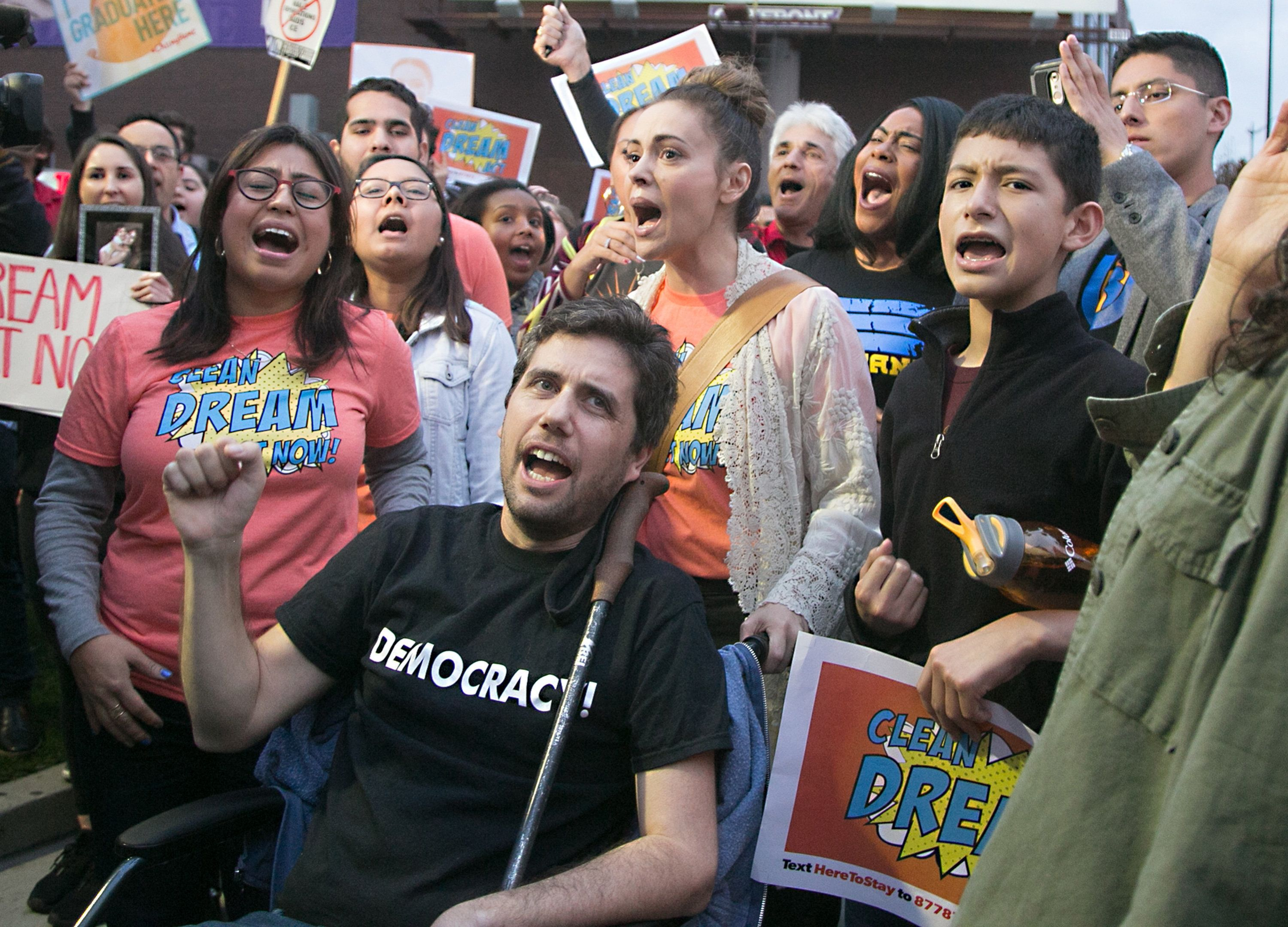 "Ady Barkan, center, participates in a protest earlier this month for a ""clean"" Dream Act outside the Los Angeles office of Se"
