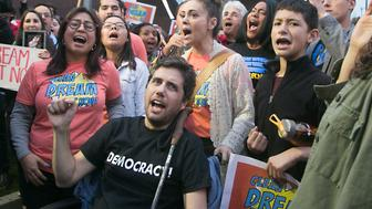 LOS ANGELES, CA - JANUARY 03:  Actress Alyssa Milano and Ady Barkan (C) attend the Los Angeles Supports a Dream Act Now! protest at the office of California Senator Dianne Feinstein on January 3, 2018 in Los Angeles, California.  (Photo by Gabriel Olsen/Getty Images)