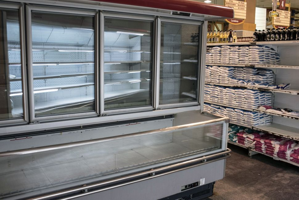 An empty refrigerator unit at a grocery store in Caracas.