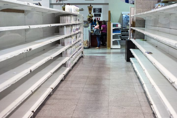 Nearlyempty shelves at a store in Caracas, Venezuela.