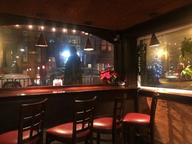 Inside the bar of Justin's.