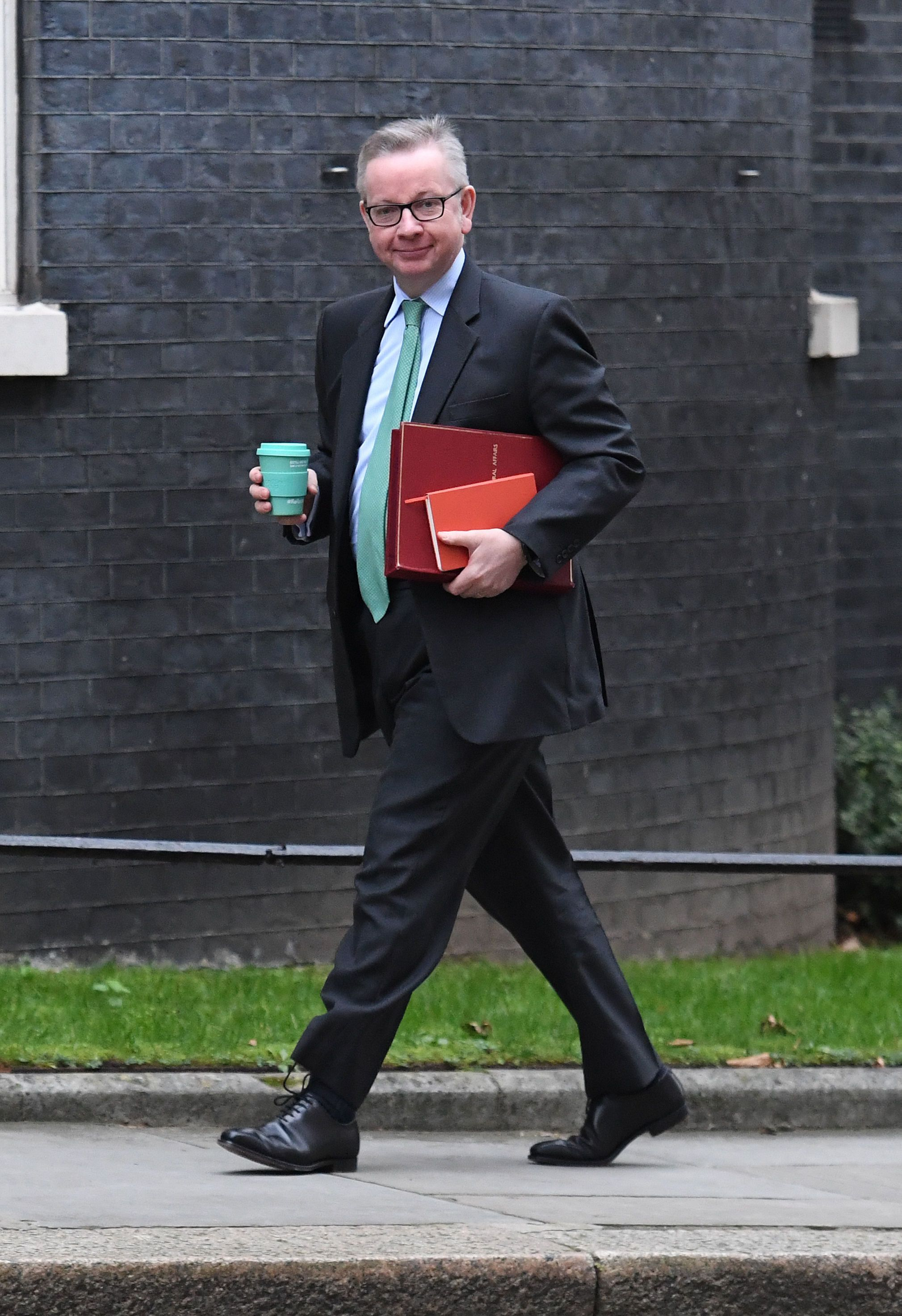 <i>Environment Secretary Michael Gove holds a reusable coffee cup as he arrives in Downing Street for a Cabinet meeting.</i>