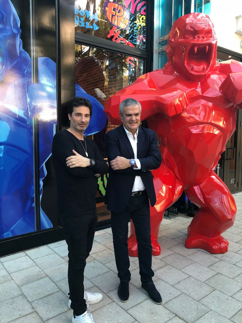 Artist Richard Orlinski and Hublot CEO Ricardo Guadalupe pictured outside the Hublot boutique in Miami Florida, with a view o