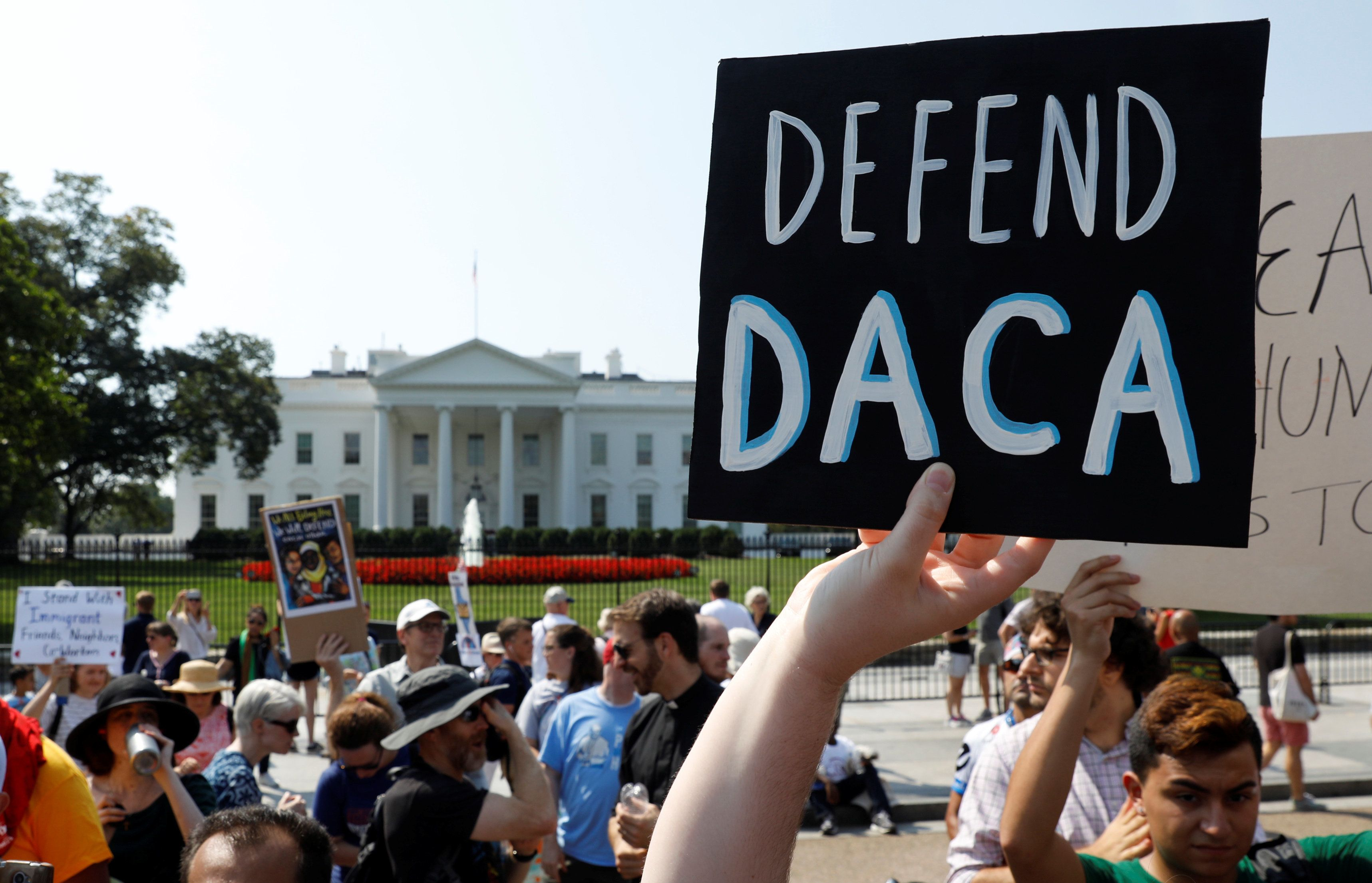 Demonstrators protest in front of the White House after the Trump administration today scrapped the Deferred Action for Childhood Arrivals (DACA), a program that protects from deportation almost 800,000 young men and women who were brought into the U.S. illegally as children, in Washington, U.S., September 5, 2017. REUTERS/Kevin Lamarque     TPX IMAGES OF THE DAY