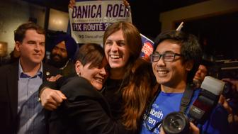 MANASSAS, VA - NOVEMBER 7: Danica Roem, C, who ran for house of delegates against GOP incumbent Robert Marshall, is greeted by supporters as she prepares to give her victory speech with Prince William County Democratic Committee at Water's End Brewery on Tuesday, November 7, 2017, in Manassas, VA.  Roem is the first transgender legislator elected in the USA. (Photo by Jahi Chikwendiu/The Washington Post via Getty Images)