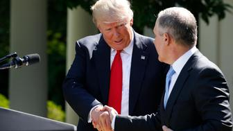 U.S. President Donald Trump (L) greets EPA Administrator Scott Pruitt after announcing his decision that the United States will withdraw from the Paris Climate Agreement, in the Rose Garden of the White House in Washington, U.S., June 1, 2017. REUTERS/Joshua Roberts