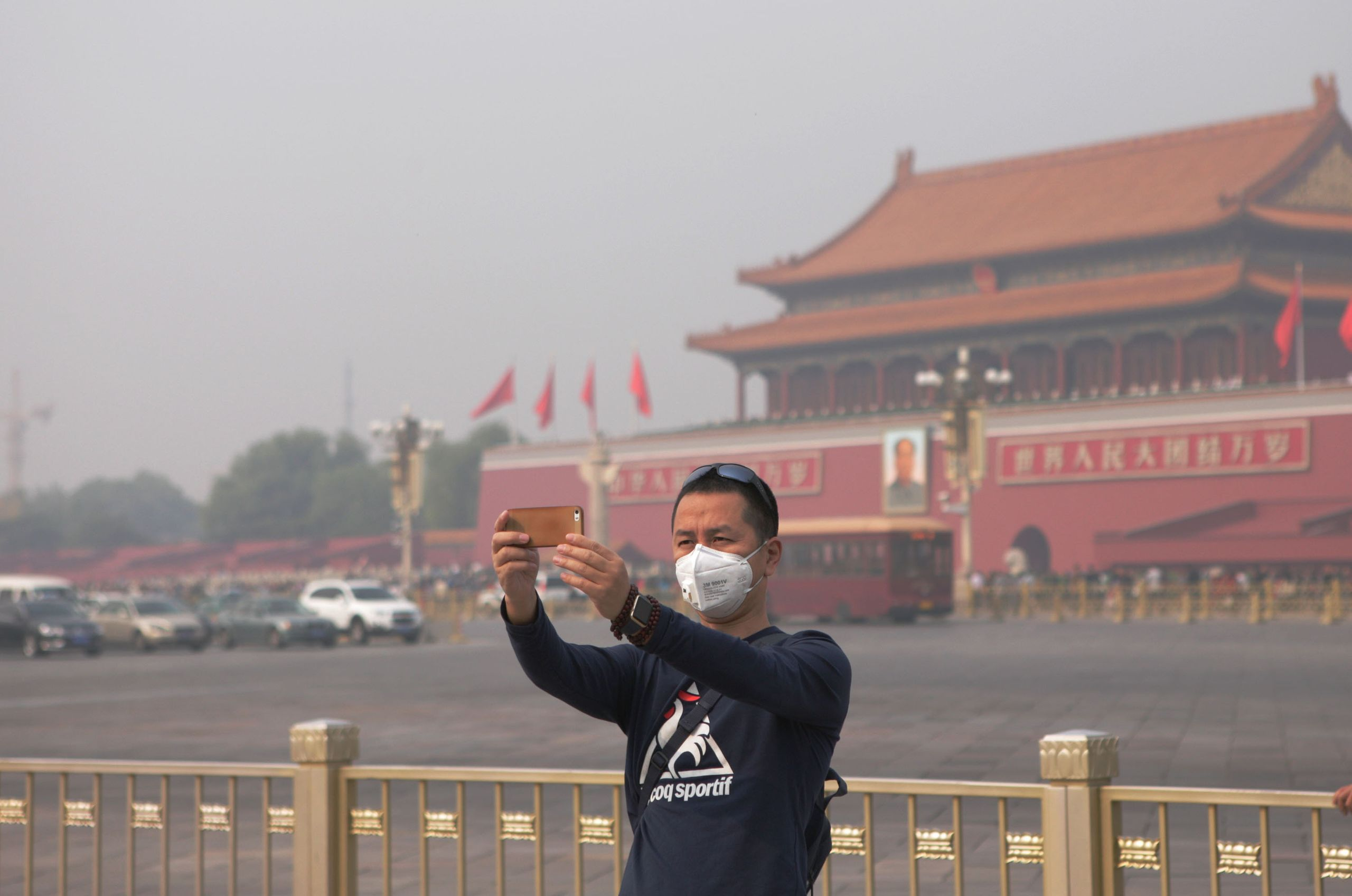 A man wears a face mask while taking a selfie in Beijing in 2015. Ed Avol, a professor of clinical preventive medicine,