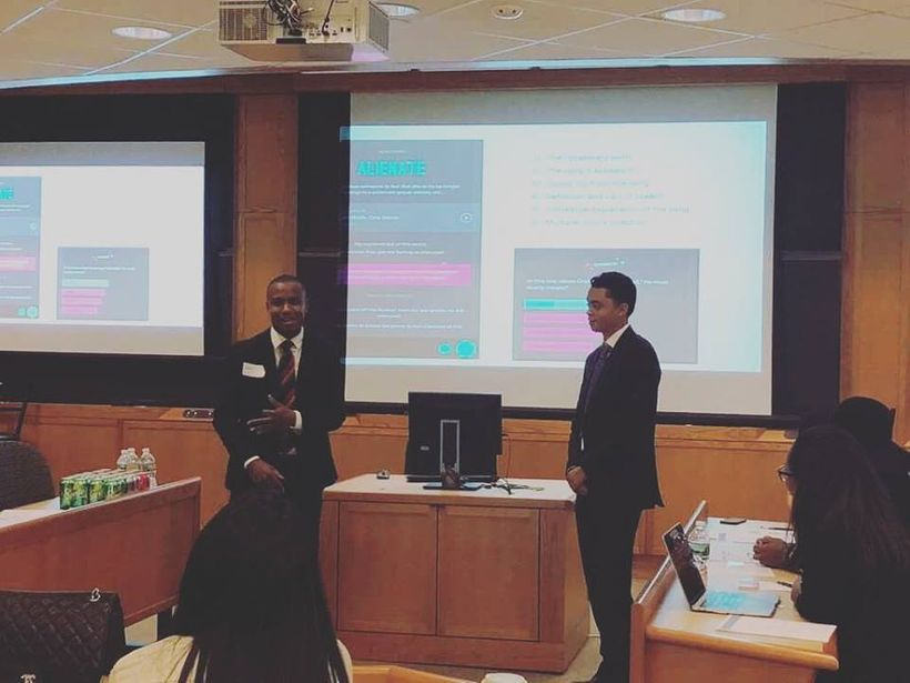 Rhymes with Reason founder Austin Martin (right) co-presenting his organization with Harvard Master's candidate Jordan Jerome