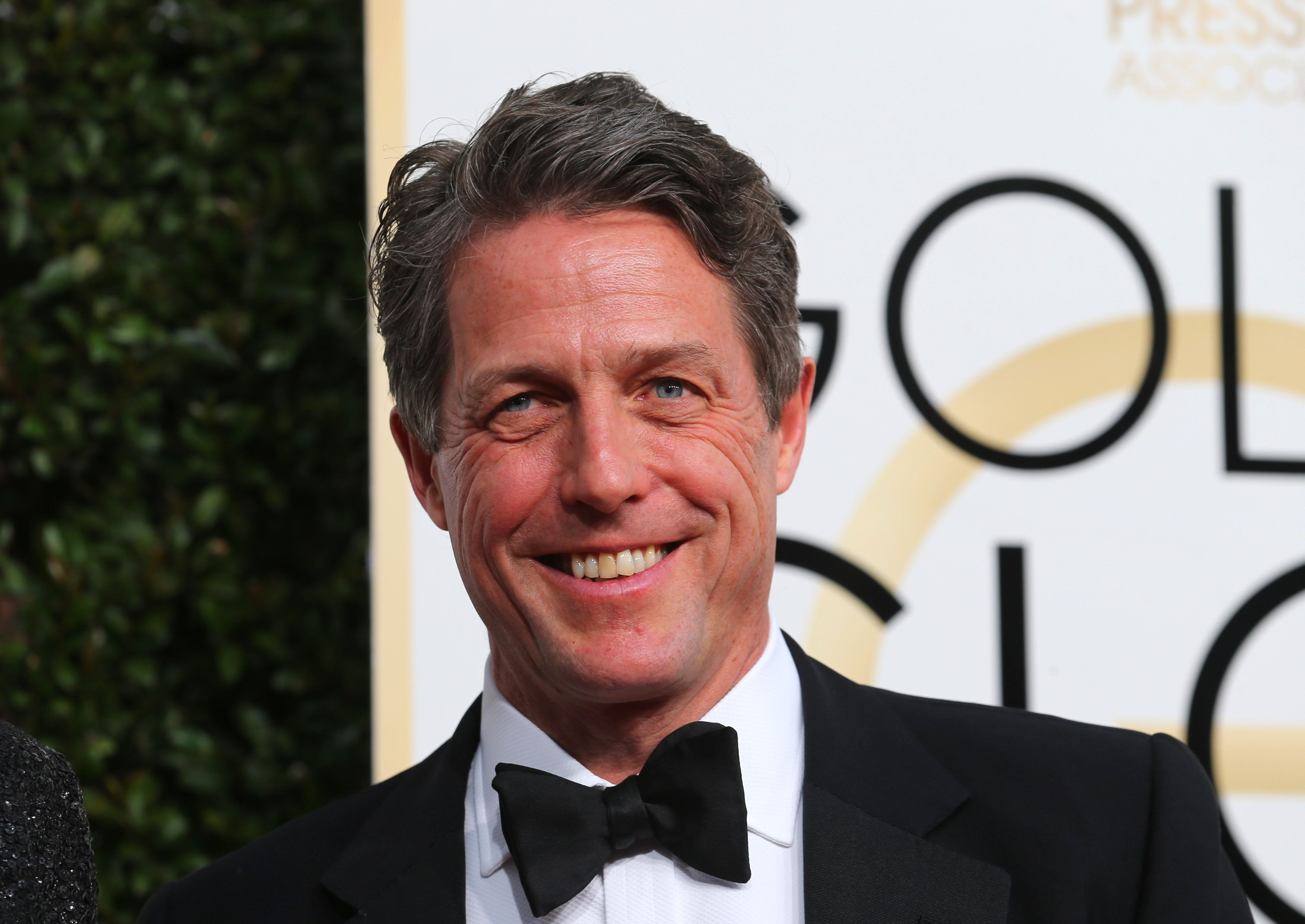 Actor Hugh Grant arrives at the 74th Annual Golden Globe Awards in Beverly Hills, California, U.S., January 8, 2017.  REUTERS/Mike Blake