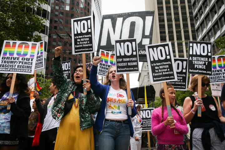 A group of marchers protest U.S. President Donald Trump in the annual LGBTQ Pride Parade on June 25, 2017 in San Francisco, C