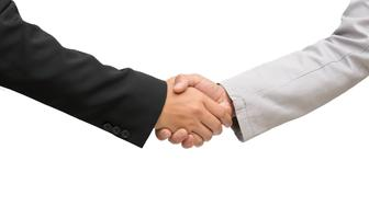 Two business man shake hands during a meeting in the office, success, dealing, agreement in business concept.