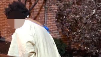 A woman was filmed wandering around outside of a Maryland hospital wearing only a hospital gown and socks early Wednesday morning