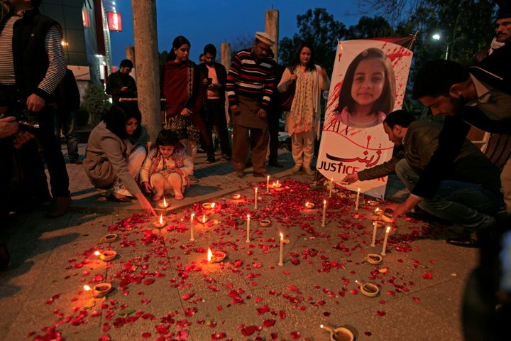Member of Civil Society light candles and earthen lamps to condemn the rape and murder of 7-year-old girl Zainab Ansari in Ka