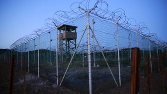 FILE PHOTO -  Chain link fence and concertina wire surrounds a deserted guard tower within Joint Task Force Guantanamo's Camp Delta at the U.S. Naval Base in Guantanamo Bay, Cuba March 21, 2016.  REUTERS/Lucas Jackson/File Photo     TPX IMAGES OF THE DAY