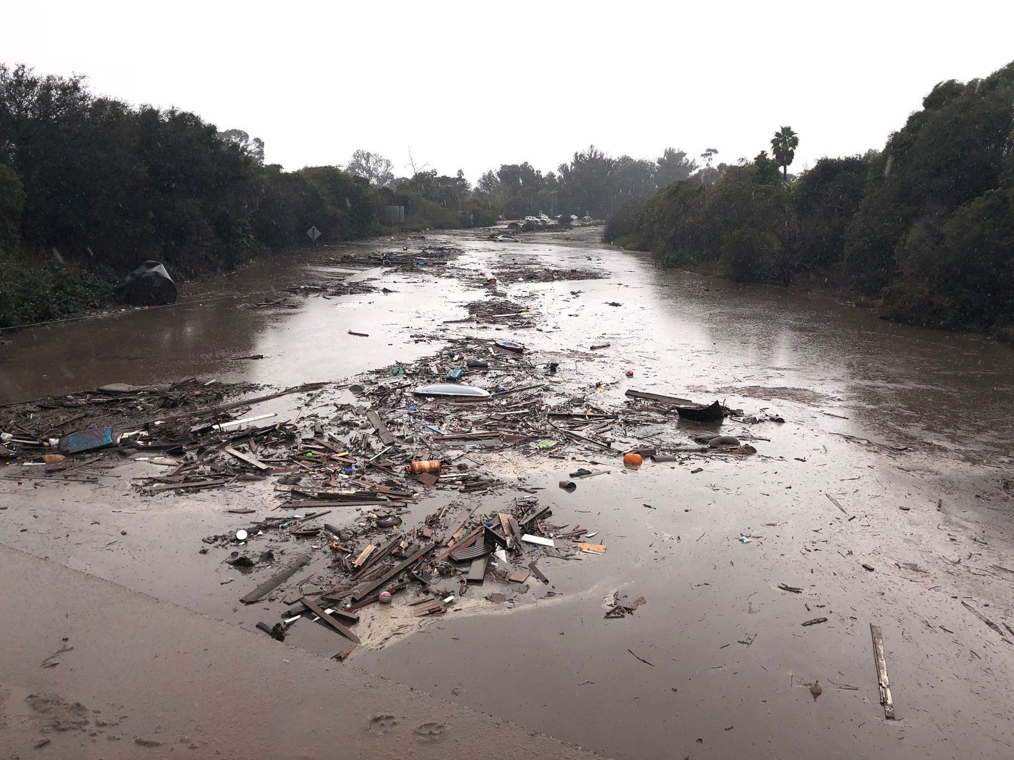 Debris floats in flooded waters on the freeway after a mudslide in Montecito, California, U.S. in this photo provided by the Santa Barbara County Fire Department, January 9, 2018.   Mike Eliason/Santa Barbara County Fire Department/Handout via REUTERS     ATTENTION EDITORS - THIS IMAGE WAS PROVIDED BY A THIRD PARTY.