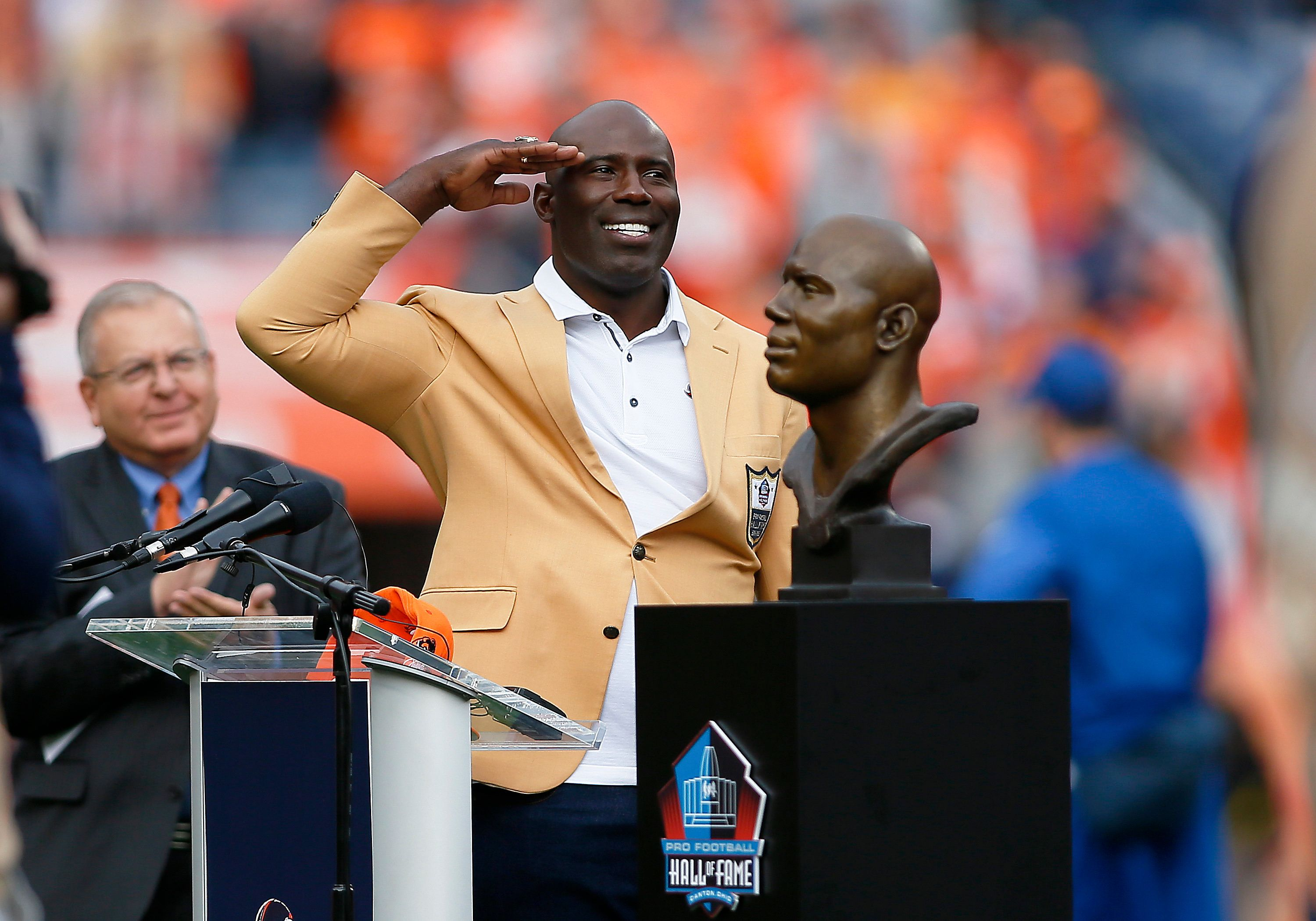 "Terrell Davis gives Broncos fans a ""Mile High salute"" after being honored with his Hall of Fame induction before th"