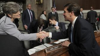 WASHINGTON, DC - NOVEMBER 02:  Senate Armed Services Committee member Rep. Joni Ernst (R-IA) (L) greets Mark Esper before his confirmation hearing to be secretary of the U.S. Army in the Dirksen Senate Office Building on Capitol Hill November 2, 2017 in Washington, DC. Nominated by President Donald Trump, Esper is an Army veteran and currently serves as vice president of government relations for the giant defense contractor Raytheon.  (Photo by Chip Somodevilla/Getty Images)