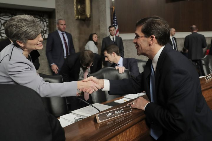 Senate Armed Services Committee member Rep. Joni Ernst (R-IA) (L) greets Mark Esper before his confirmation hearing to be sec