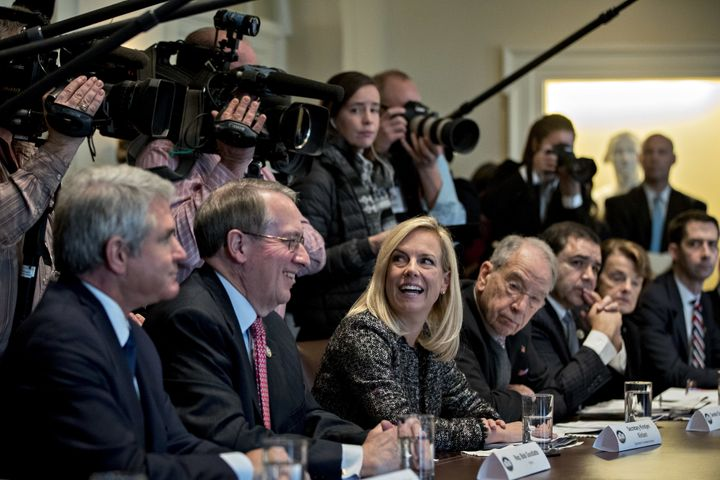 Secretary of Homeland Security Kirstjen Nielsen, center, and Rep. Bob Goodlatte (R-Va.), second left, smile during