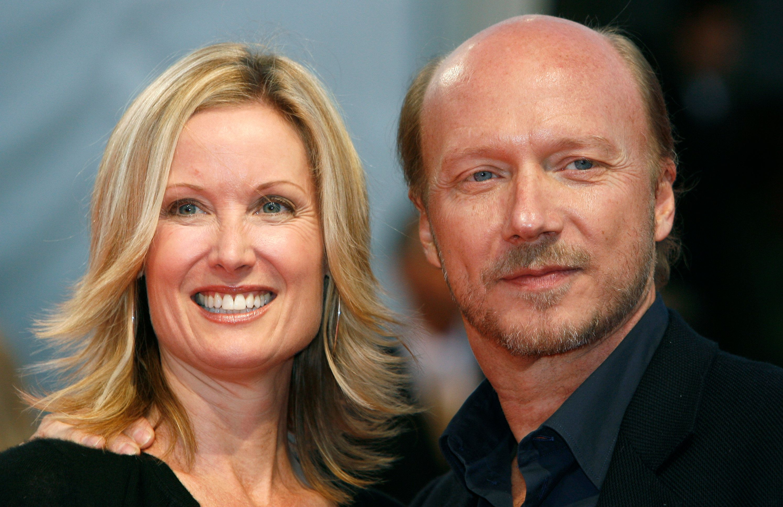 "Director Paul Haggis poses with his wife Deborah Rennard as they arrive for the screening of his film ""In The Valley of Elah"" at the 33rd Deauville American Film Festival September 4, 2007.  REUTERS/Vincent Kessler  (FRANCE)"