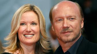 """Director Paul Haggis poses with his wife Deborah Rennard as they arrive for the screening of his film """"In The Valley of Elah"""" at the 33rd Deauville American Film Festival September 4, 2007.  REUTERS/Vincent Kessler  (FRANCE)"""