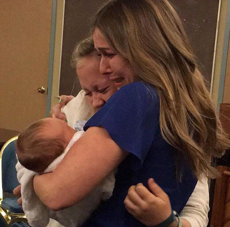 Hannah Mongie as she gave her baby Taggart to his adoptive mum, Emily