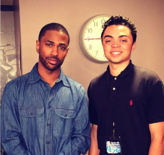 Rhymes with Reason founder Austin Martin (right) posing with rapper Big Sean after presenting at the 2017 internationally acc