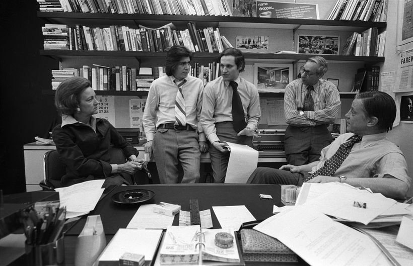 Washington Post publisher Katharine Graham with reporters Carl Bernstein, Bob Woodward, editor Howard Simons discuss the Wate
