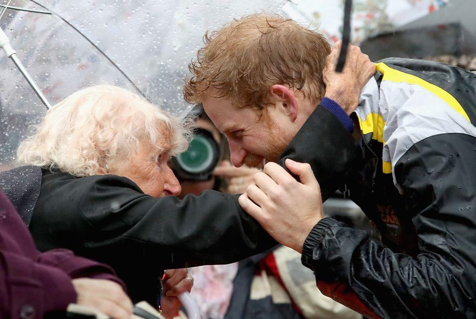 Jackson calls Prince Harry 'a hugger'. Here, the photographer captures the Royal hugging Daphe Dunne,...