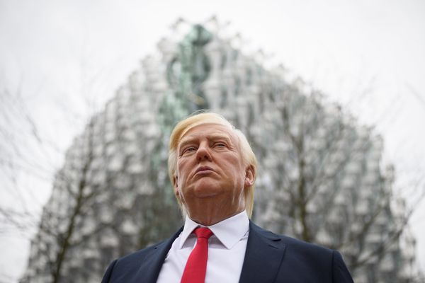A model of President Donald Trump from Madame Tussauds waxwork attractions standsoutside the new U.S. Embassy in London