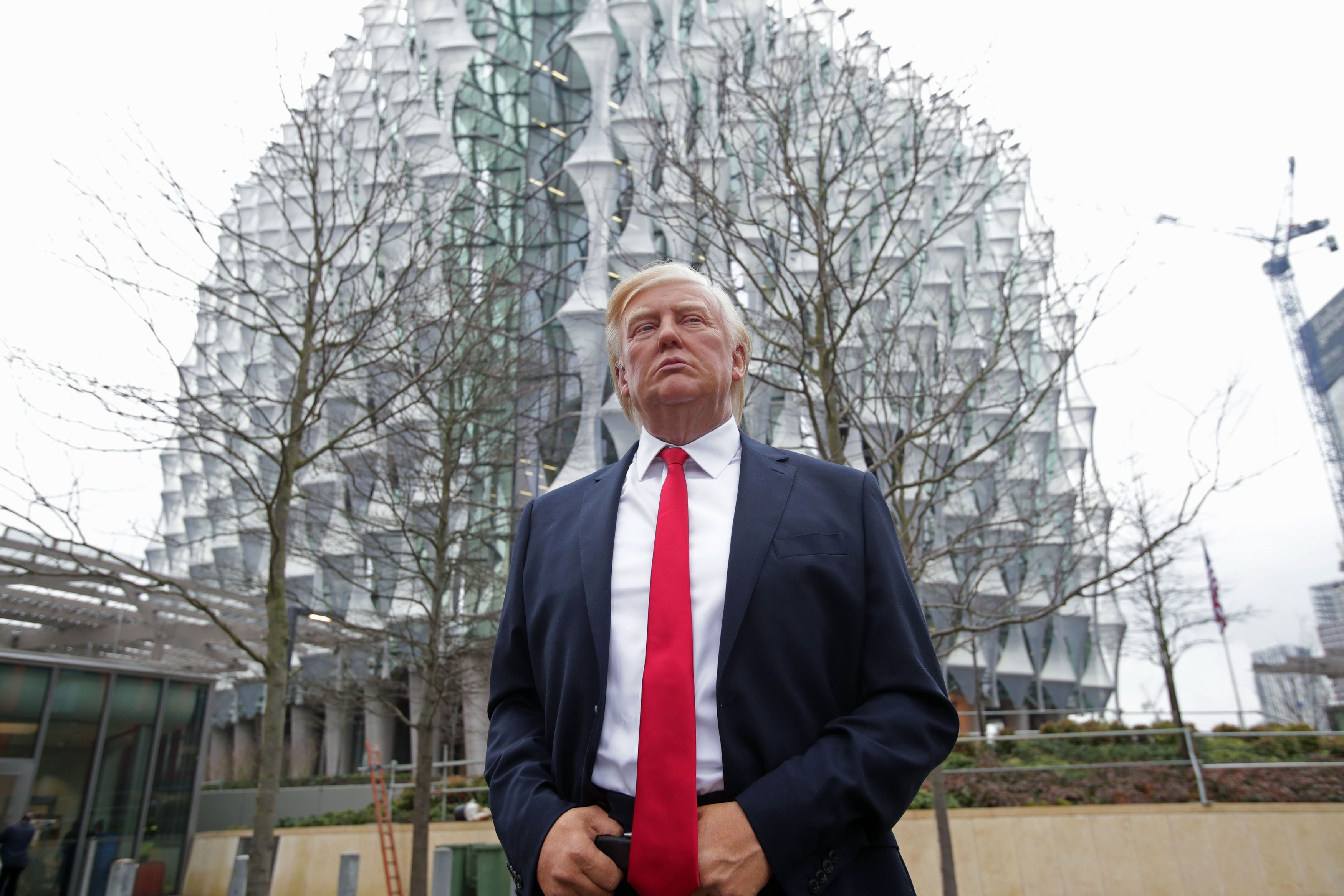PA Wire  PA Images                   The Madame Tussauds wax figure of Donald Trump outside the new US Embassy in Nine Elms London