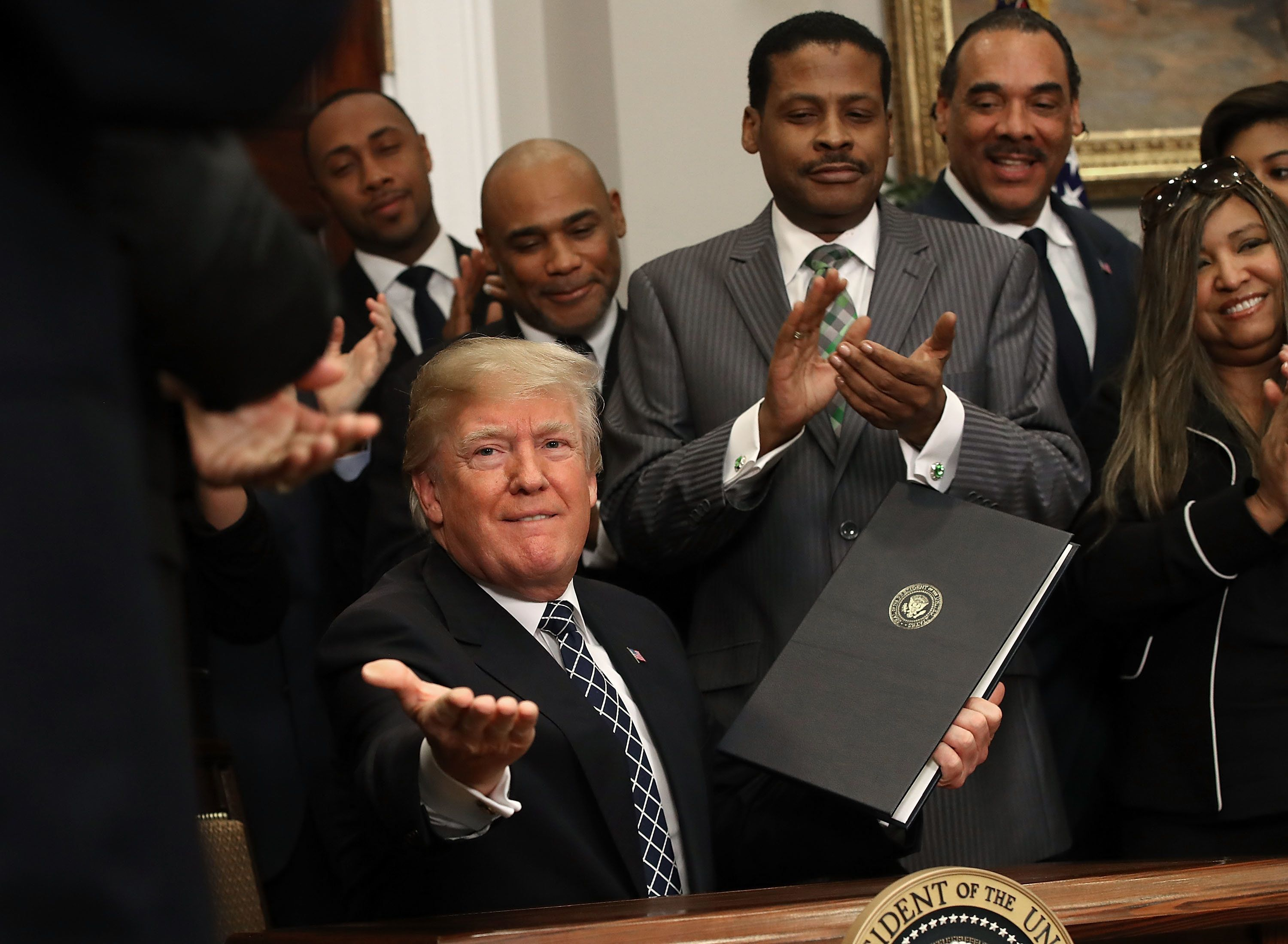 WASHINGTON, DC - JANUARY 12: U.S. President Donald Trump receives applause from members of the African American community after signing a proclamation to honor Martin Luther King, Jr. day, in the Roosevelt Room at the White House, on January 12, 2018 in Washington, DC. Monday January 16 is a federal holiday to honor Dr. King and his legacy.  (Photo by Mark Wilson/Getty Images)