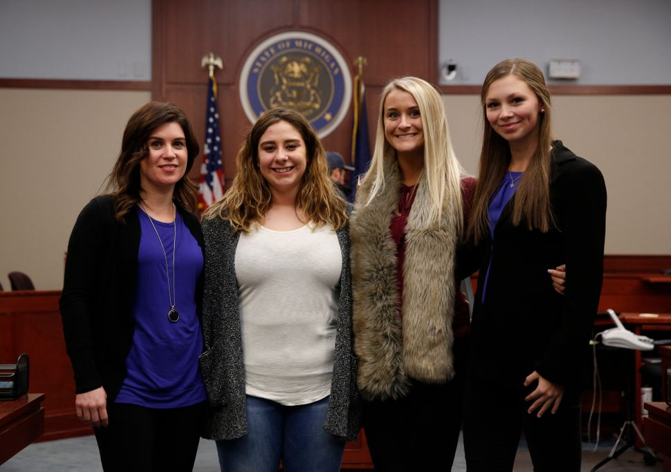 Nassar survivors Larissa Boyce, Alexis Alvarado, Christine Harrison and Jessica Smith (left to right) pose for a picture