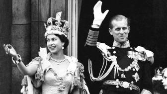 Queen Elizabeth II wearing the Imperial State Crown and the Duke of Edinburgh in uniform of Admiral of the Fleet wave from the balcony to the onlooking crowds around the gates of Buckingham Palace after the Coronation.   (Photo by PA Images via Getty Images)