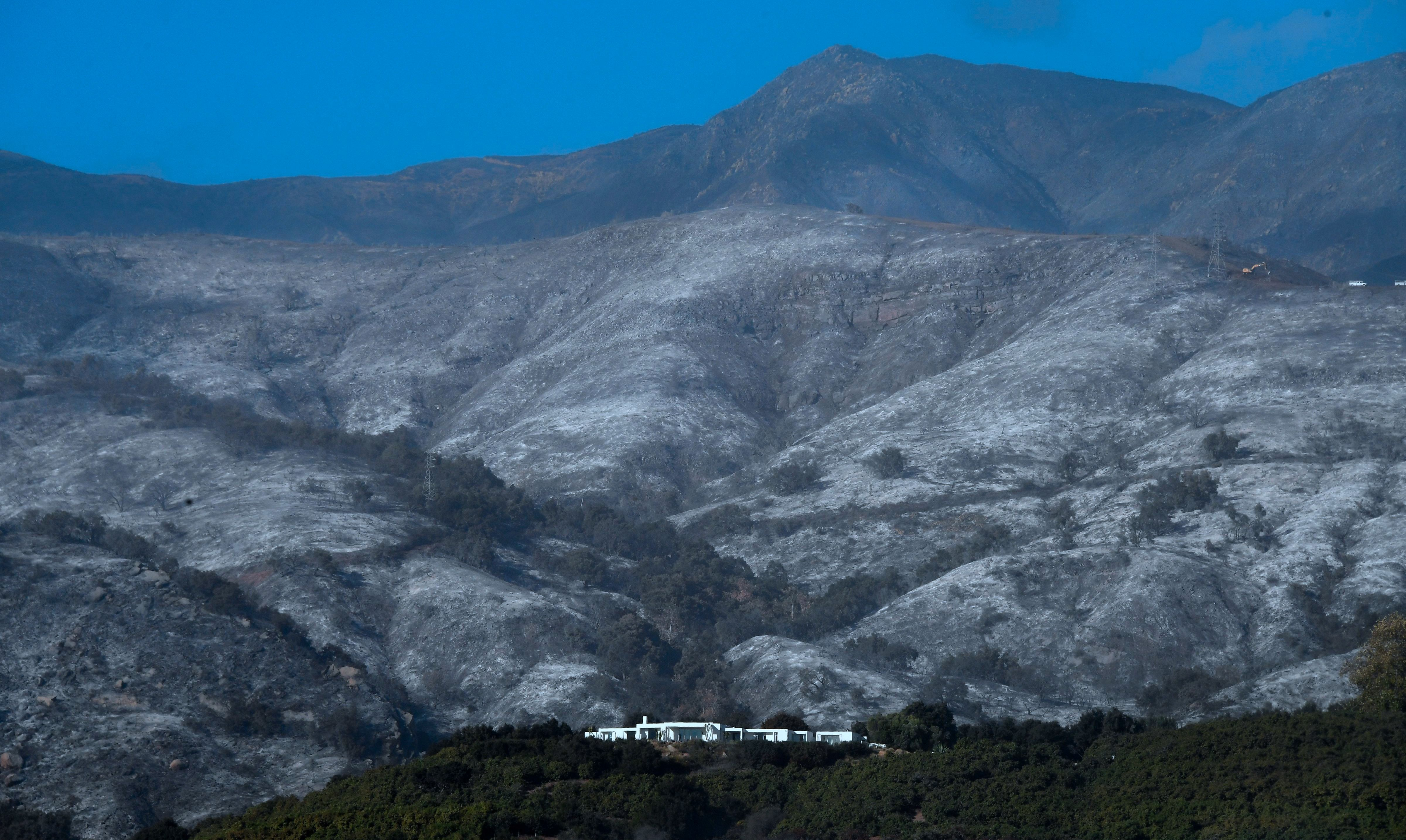 FREDERIC J. BROWN via Getty Images A house remains standing in front of an ash-filled hillside in Montecito California on Dec. 20