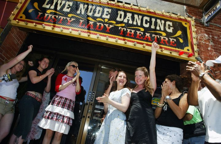 Dancers and staff at the Lusty Lady in San Francisco celebrate its reopening in June 2003 after it became the first employee-