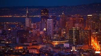 Night view of the San Francisco downtown district and skyscrapers towards bay from the hill