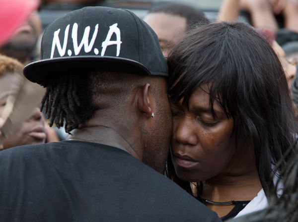 Sandra Sterling, is comforted during a community vigil in memory of her nephew, Alton Sterling.