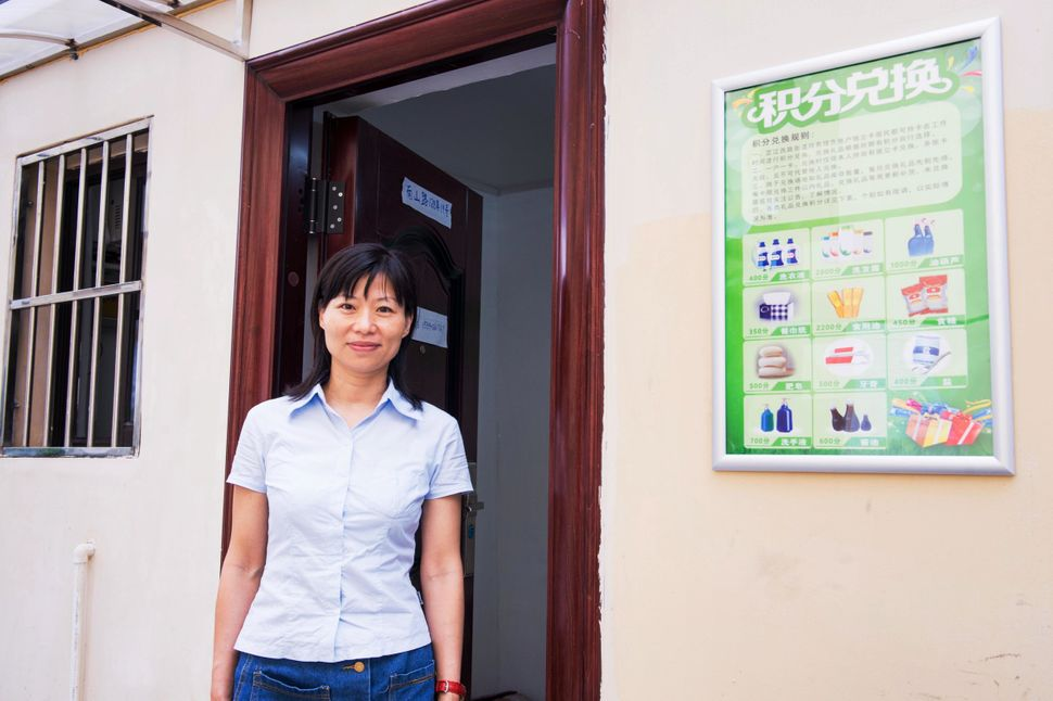Zhang Qin is an employee of a new neighborhood recycling center in Shanghai. She spends her days in a small windowl