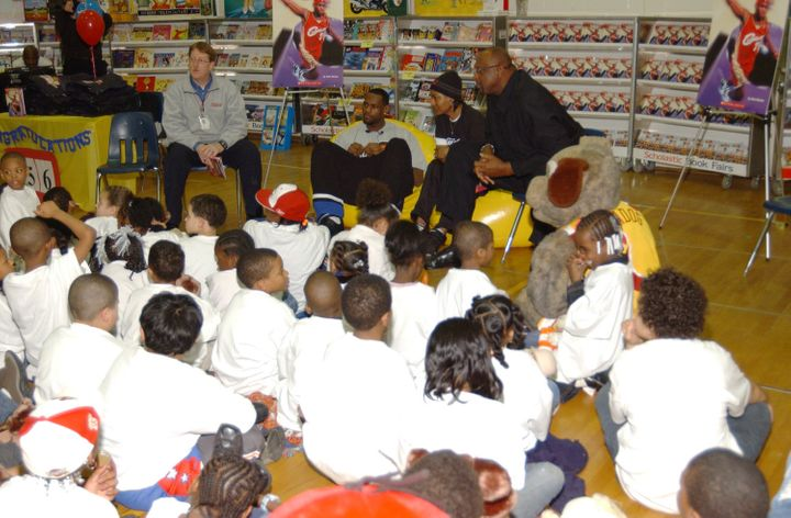 NBA player Lebron James (center) attends a Scholastic Book Fair at Portage Path Elementary School in Akron, Ohio.