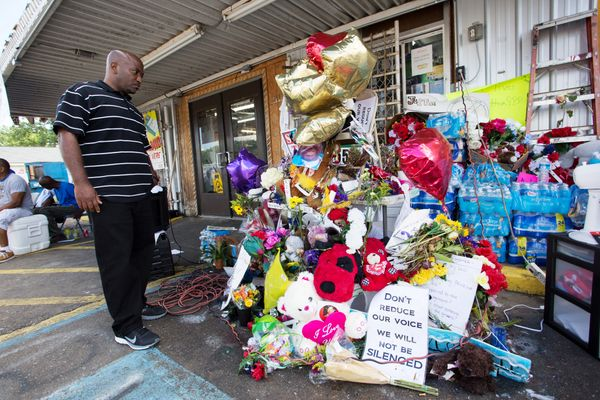 Cleve Dunn Jr. takes a moment to reflect at an impromptu memorial for Alton Sterling at the Triple S Food Mart.