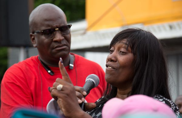 Sandra Sterling, speaks at a community vigil in memory of her nephew, Alton Sterling.