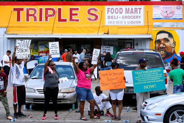 Protesters demonstrate outside the Triple S Food Mart where Alton Sterling was shot dead.