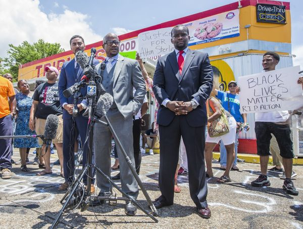 Attorneys Justin Bamberg, Chris Stewart and Dale Glover speak to the media in front of the Triple S Mart.