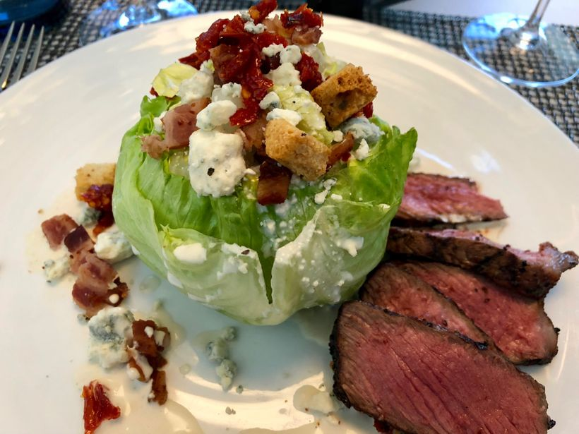 Steak and wedge salad at Classified