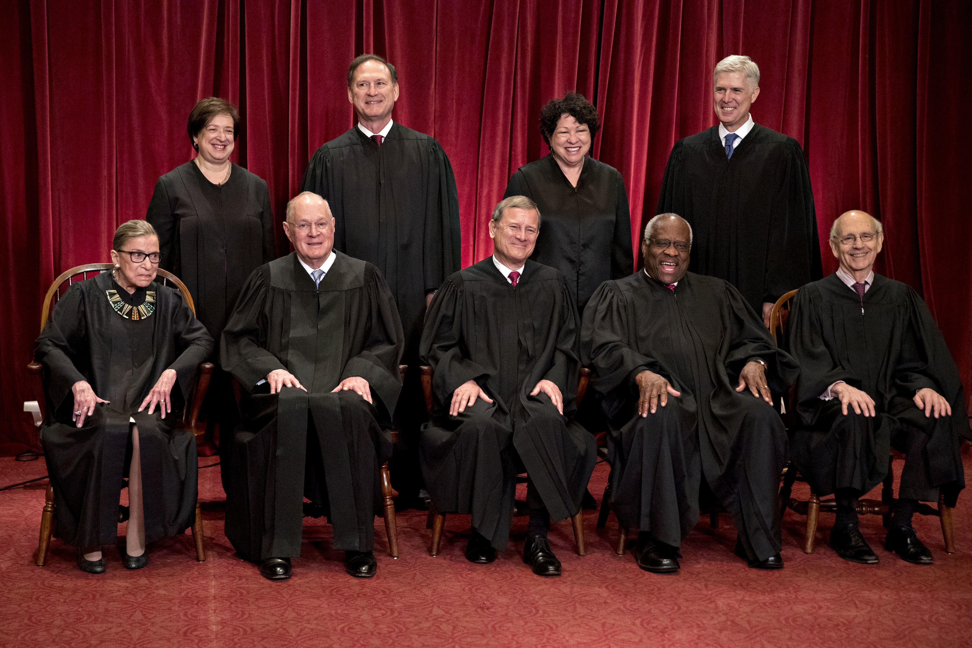 Bloomberg Best of the Year 2017: Justices of the U.S. Supreme Court pose for a formal group photograph in the East Conference Room of the Supreme Court, seated left to right, Associate Justice Ruth Bader Ginsburg, Associate Justice Anthony Kennedy, Chief Justice John Roberts, Associate Justice Clarence Thomas, Associate Justice Stephen Breyer, and standing left to right, Associate Justice Elena Kagan, Associate Justice Samuel Alito Jr., Associate Justice Sonia Sotomayor, and Associate Justice Neil Gorsuch in Washington, D.C., U.S., on Thursday, June 1, 2017. Photographer: Andrew Harrer/Bloomberg via Getty Images