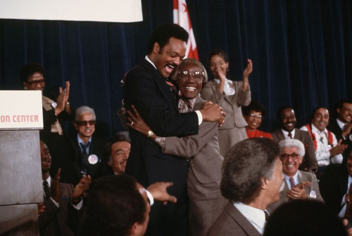 The Rev. Jesse Jackson hugs former New York congresswoman and presidential candidate Shirley Chisholm in 1983 after announcin